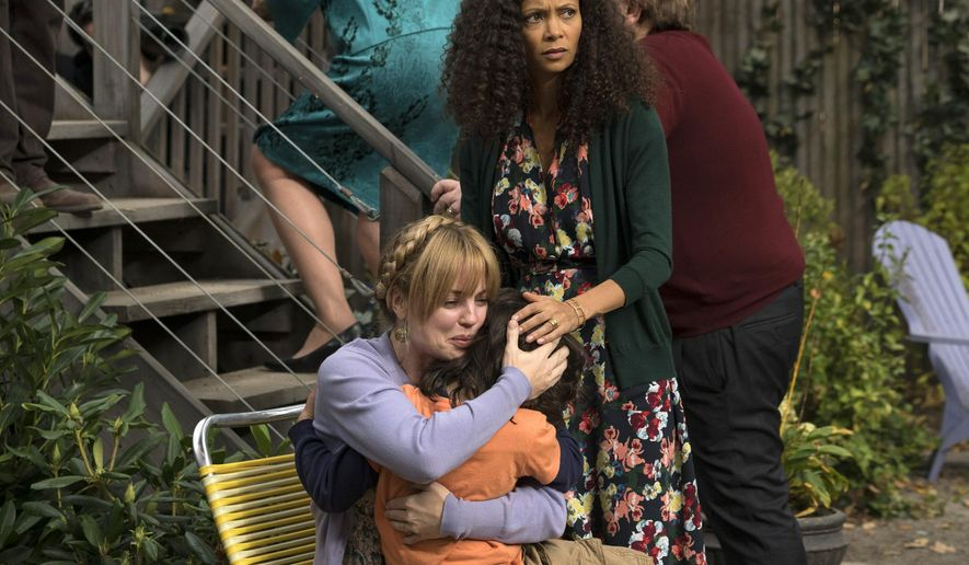 "In this image released by NBC, Dylan Schombing, Melissa George, left, and Thandie Newton, right, appear in a scene from ""The Slap,"" an eight-hour miniseries premiering Thursday at 8 p.m. EST on NBC.  (AP Photo/NBC,  Virginia Sherwood)"