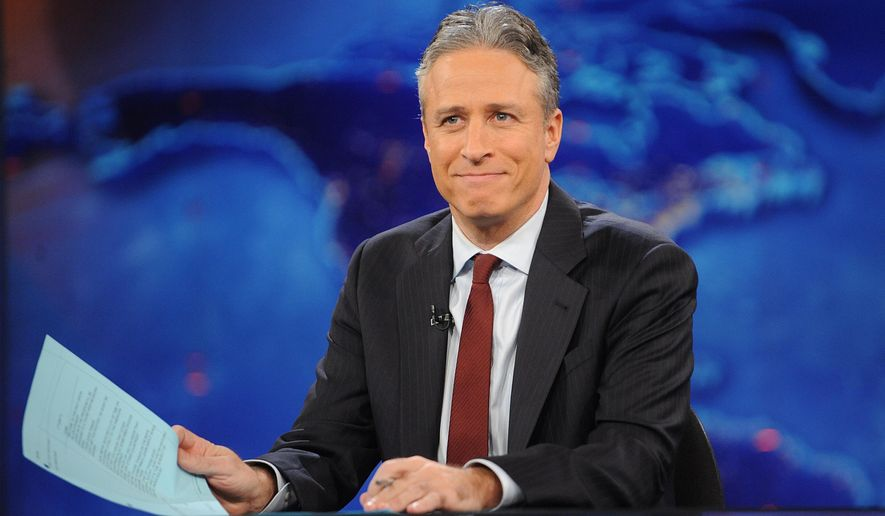 "FILE - This Nov. 30, 2011 file photo shows television host Jon Stewart during a taping of ""The Daily Show with Jon Stewart"" in New York. Comedy Central announced Tuesday, Feb. 10, 2015, that Stewart will will leave ""The Daily Show"" later this year. (AP Photo/Brad Barket, File)"