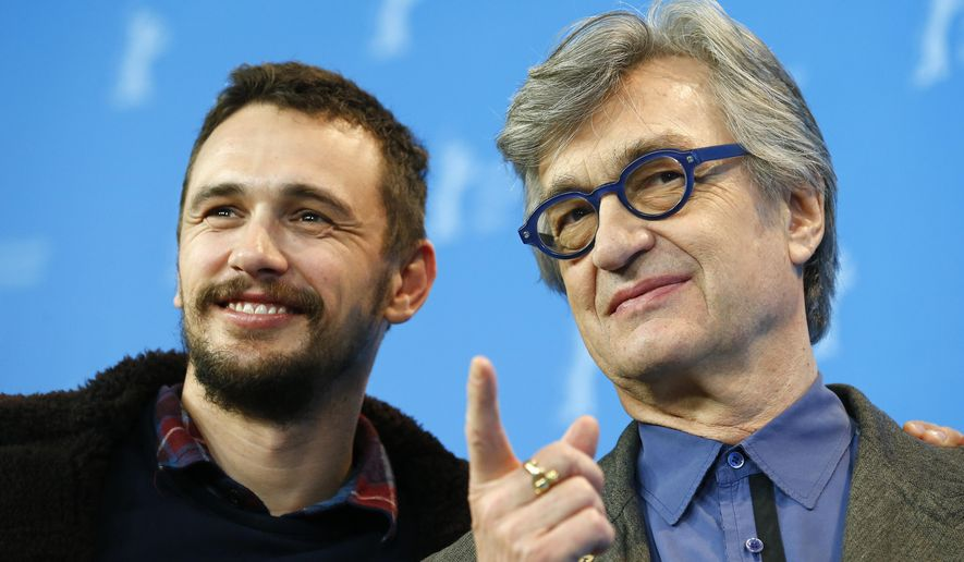 From left, actor James Franco and director Wim Wenders pose for photographers at the photo call for the film Every Thing Will Be Fine at the 2015 Berlinale Film Festival in Berlin, Tuesday,Feb. 10, 2015. (AP Photo/Axel Schmidt)