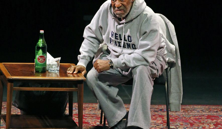 FILE - In this Jan. 17, 2015 file photo, comedian Bill Cosby performs at the Buell Theater in Denver. Cosby is scheduled to perform his comedy routine at Boston's Wilbur Theater Sunday, Feb. 8, 2015. He faces sexual assault accusations from several women, with some of the claims dating back decades. He has denied the allegations through his attorney and has never been charged with a crime. (AP Photo/Brennan Linsley, File)
