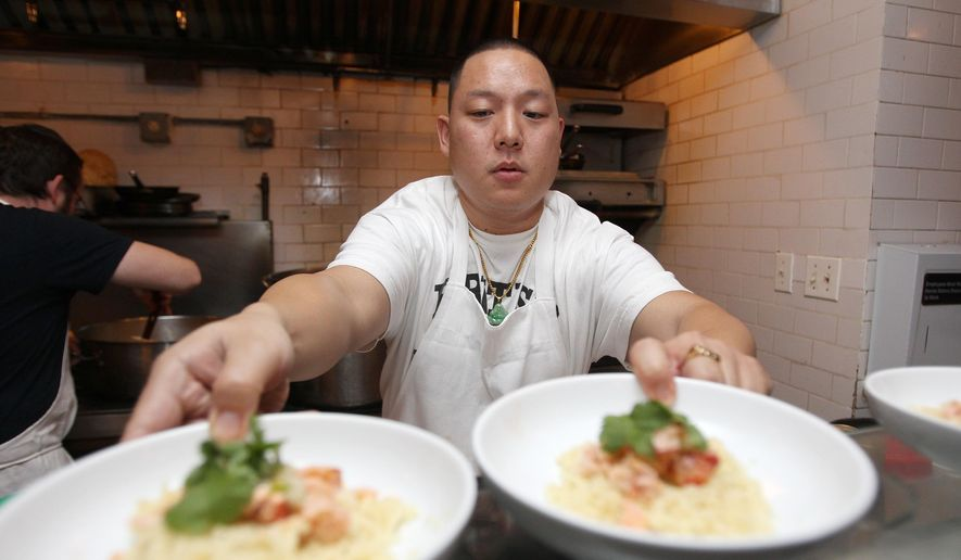 Eddie Huang prepares a Chinese New Year dinner sponsored by Hennessy VSOP Privilege at No. 7 Restaurant on Monday, Feb. 9, 2015, in New York. (Photo by Donald Traill/Invision/AP)
