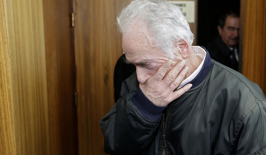 Pierre Le Guennec leaves the Grasse criminal court, Tuesday, Feb. 10, 2015, in Grasse, southeastern France, to face charges of receiving stolen goods from former painter Picasso. Was Picasso just a generous employer, or did one of his former employees steal nearly 300 of his works of art? A court in France is contemplating that mystery in a three-day trial of Picasso's former electrician Pierre Le Guennec and his wife Danielle. (AP Photo/Lionel Cironneau)