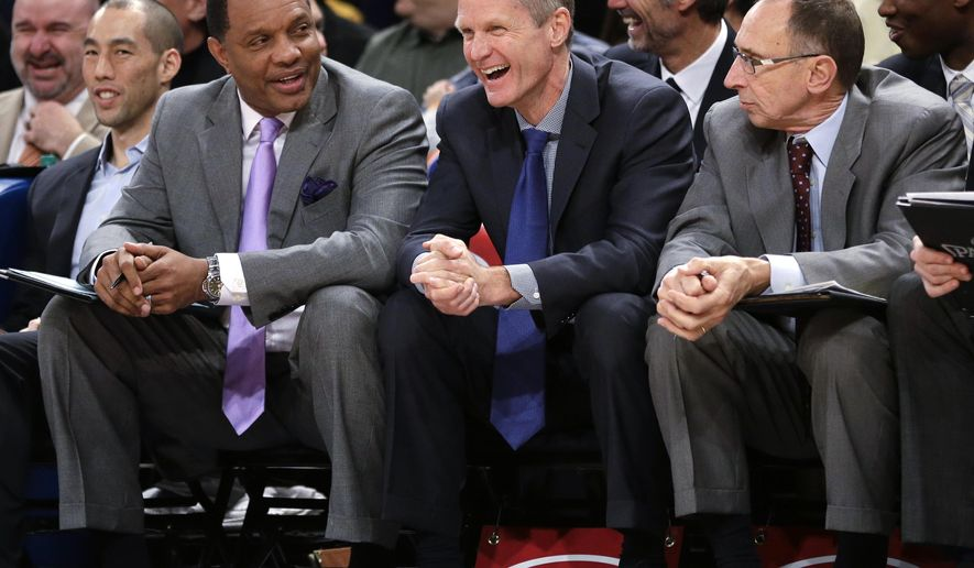 Golden State Warriors coach Steve Kerr center, laughs during the first half of his team's NBA basketball game against the New York Knicks on Saturday, Feb. 7, 2015, in New York. (AP Photo/Frank Franklin II)