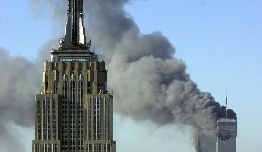 Plumes of smoke rise from the World Trade Center buildings in New York in this Sept. 11, 2001, photo taken after the infamous terror attacks perpetrated by al Qaeda. (AP Photo/Patrick Sison) ** FILE **