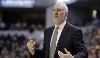 San Antonio Spurs head coach Gregg Popovich watches during the first half of an NBA basketball game against the Indiana Pacers Monday, Feb. 9, 2015, in Indianapolis. (AP Photo/Darron Cummings)