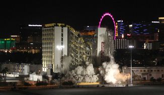 The Clarion hotel and casino is imploded, early Tuesday, Feb. 10, 2015, in Las Vegas. The 200-room casino-hotel opened in 1970 as the Royal Inn and was called the Debbie Reynolds, for its one-time owner, as well as the Greek Isles and the Paddle Wheel. The Clarion is the first hotel to be imploded since 2007. (AP Photo/Las Vegas Sun, Steve Marcus)
