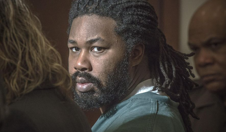 FILE - In this Nov. 14, 2014 file photo Jesse Matthew Jr., right, looks toward the gallery while appearing in court in Fairfax, Va.   New information is coming in the case against Matthew Jr., linked to two Virginia college students who disappeared and were later found dead.  Matthew, 33,  is charged with abduction with intent to defile in the case of University of Virginia student Hannah Graham.  (AP Photo/The Washington Post, Bill O'Leary, Pool)