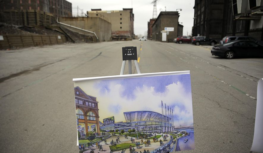 An artist's rendering of a proposed NFL stadium sits on an easel just prior to the start of a news conference by Missouri Gov. Jay Nixon Tuesday, Feb. 10, 2015, at the site of the project in a blighted area north of downtown St. Louis. The governor gave an update on the on progress of a proposed 64,000-seat, open-air football stadium that would replace the indoor Edward Jones Dome. (AP Photo/Jeff Roberson)