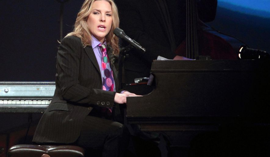 """FILE - In this April 16, 2013 file photo, Canadian jazz pianist and singer Diana Krall performs onstage during her Glad Rag Doll World Tour in Wilmington, Del. For her 12th album, """"Wallflower,"""" Krall enlisted fellow Canadian David Foster, a 16-time Grammy winner. Foster did the arrangements and played most of the piano parts, freeing Krall to focus on her vocals. (Photo by Owen Sweeney/Invision/AP, File)"""