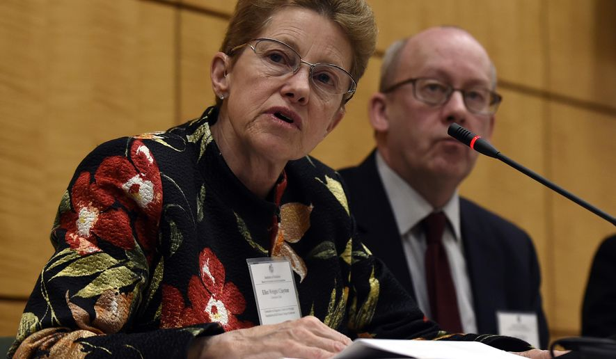 Dr. Ellen Wright Clayton, chair of the Committee on Diagnostic Criteria for Myalgic Encephalomyelitis/Chronic Fatigue Syndrome, left, speaks during an open meeting at the Institute of Medicine in Washington, Tuesday, Feb. 10, 2015. Chronic fatigue syndrome is a real and serious disease that needs a new name to reflect that _ and a straightforward way to diagnose the illness, a government advisory group declares. The new name, Systemic Exertion Intolerance Disease, better reflects the hallmark symptoms of this mysterious illness, namely, that patients can be wiped out by exertion. Committee member Peter Rowe sits at right.(AP Photo/Susan Walsh)
