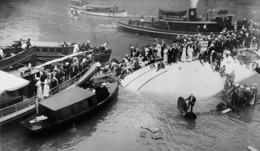 FILE - In this July 24, 1915 file photo, passengers are rescued as they stand atop the Eastland passenger ship after the vessel capsized in the Chicago River in downtown Chicago. Film clips have surfaced of the 1915 disaster that left 844 people dead. The first-known footage of the Eastland disaster was spotted by Jeff Nichols, a doctoral student at the University of Illinois at Chicago who was looking through seemingly unrelated material on World War I. (AP Photo/File)