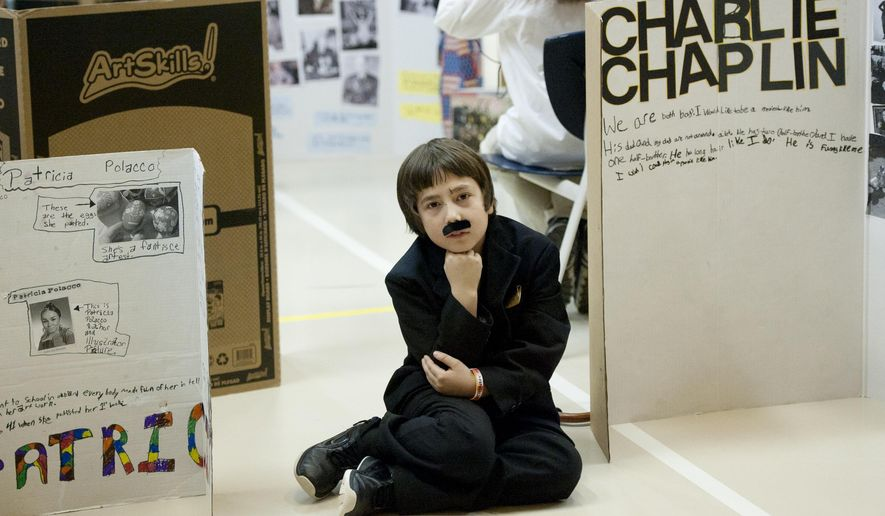 In this photo taken Jan. 30, 2015, Malachi Warner, 10, portrays Charlie Chaplin during a fourth grade wax museum at Concord Elementary School in Concord, Mich. The students picked someone they admired to do a project on and dress up like for the museum. (AP Photo/The Jackson Citizen Patriot, J. Scott Park) ALL LOCAL TELEVISION OUT; LOCAL TELEVISION INTERNET OUT
