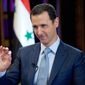 In this photo released on Tuesday, Feb. 10, 2015, by the Syrian official news agency SANA, Syrian President Bashar Assad gestures during an interview with the BBC, in Damascus, Syria. Assad said in comments published Tuesday that his government has been receiving general messages from the American military about airstrikes targeting the Islamic State group inside Syria but that there is no direct cooperation. (AP Photo/SANA)