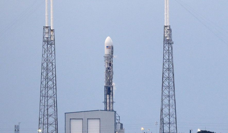 A Falcon 9 SpaceX rocket stands on launch complex 40 moments after the launch attempt was scrubbed because of upper level winds at the Cape Canaveral Air Force Station in Cape Canaveral, Fla., Tuesday, Feb. 10, 2015. If a Wednesday attempt is unsuccessful, SpaceX will have to wait till Feb. 20. (AP Photo/John Raoux)