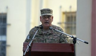 Army Gen. John F. Campbell will explain to lawmakers why he tried to conceal from taxpayers how money is being spent on bolstering Afghanistan's nascent security forces and then reversed himself. (Associated Press)