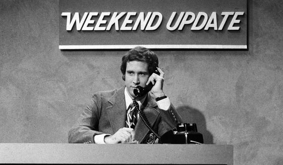 """In this Oct. 11, 1975 photo released by NBC, Chevy Chase performs during a """"Weekend Update"""" sketch on """"Saturday Night Live,"""" in New York. The long-running sketch comedy series will celebrate their 40th anniversary with a 3-hour special airing Sunday at 8 p.m. EST on NBC. (AP Photo/NBC, Herb Ball)"""