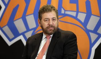 In this March 18, 2014, file photo,  New York Knicks owner James Dolan listens to a question during a news conference in New York. He is the owner many Knicks fans love to hate, the guy they blame for the team's failings. He's also a wildly successful businessman bringing in money for his companies and leagues. So James Dolan isn't going anywhere.  (AP Photo/Richard Drew, File)
