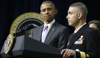 President Barack Obama listens as he is introduced by Rear Adm. Scott Giberson, Assistant U.S. Surgeon General and Public Health Service (PHS) Commander of Commissioned Corps Ebola Response in West Africa, before speaking about the Ebola outbreak response by the U.S. in West Africa, Wednesday, Feb. 11, 2015, in the South Court Auditorium of the White House complex in Washington. Obama plans to withdraw most US military troops fighting Ebola outbreak in West Africa. (AP Photo/Jacquelyn Martin) **FILE**