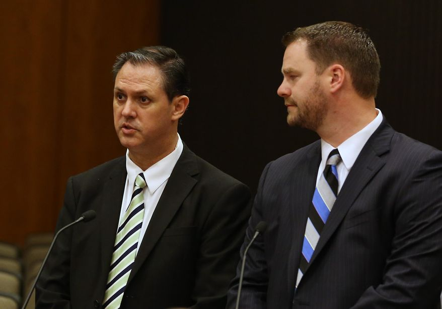 Former state employee Bryan Thurmond, left,  appears in Sacramento County Superior Court with his attorney, John Holbus for an arraignment on a misdemeanor charge of bringing a loaded gun to work last month at the secretary of state's office, in Sacramento, Calif., Wednesday, Feb. 11, 2015.  Thurmond, 51, did not enter a plea.  (AP Photo/Rich Pedroncelli)
