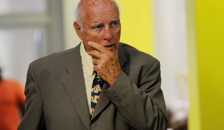 Former grand slam tennis doubles champion Bob Hewitt outside a Johannesburg court Monday, Feb. 9, 2015. Hewitt, who is on trial for rape and sexual assault of minors in the country, has pleaded not guilty. (AP Photo)