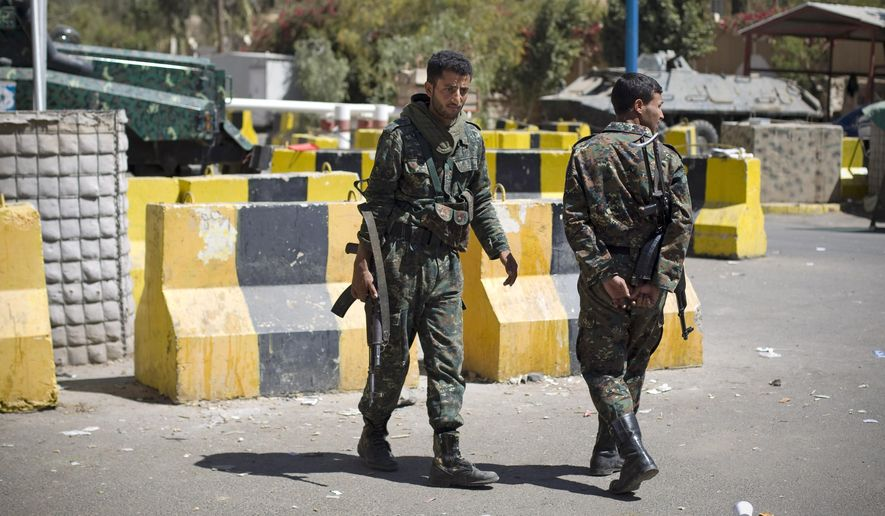 Policemen stand guard at the entrance of the U.S. Embassy in Sanaa, Yemen, Wednesday, Feb. 11, 2015. The State Department has closed the U.S. Embassy in Yemen and evacuated its staff because of the political crisis and security concerns following the takeover of much of the country by Shiite rebels. (AP Photo/Hani Mohammed)