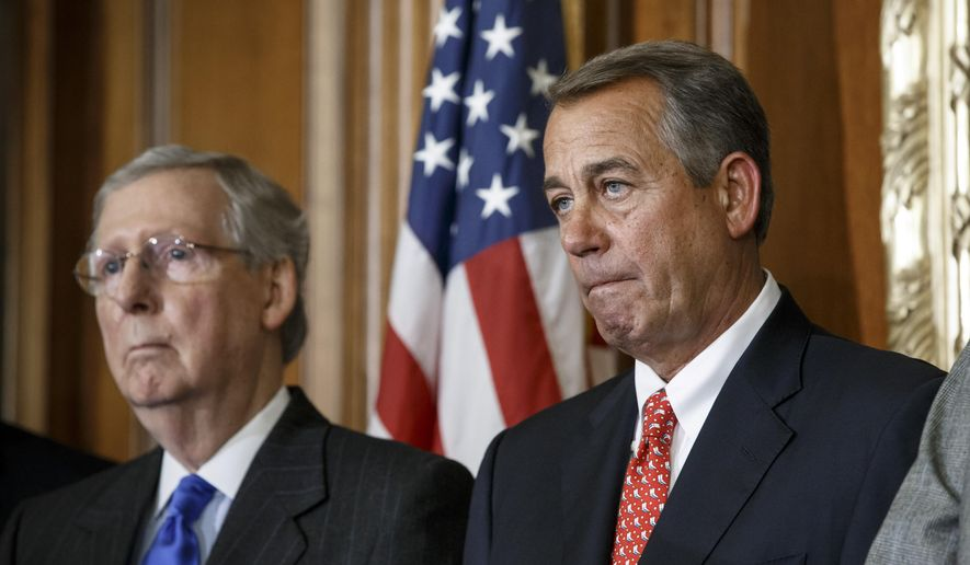 """In this photo taken Feb. 10, 2015, House Speaker John Boehner of Ohio, joined by Senate Majority Leader Mitch McConnell of Ky. are seen on Capitol Hill in Washington. Boehner says Senate Democrats should """"get off their ass"""" and pass a bill to fund the Homeland Security Department and restrict President Barack Obama's executive moves on immigration. His comments Wednesday underscored a worsening stalemate on Capitol Hill with funding for the Homeland Security Department set to expire Feb. 27. A day earlier, McConnell declared the Senate """"stuck"""" on the issue and said the next move was in the House's court.  (AP Photo/J. Scott Applewhite)"""