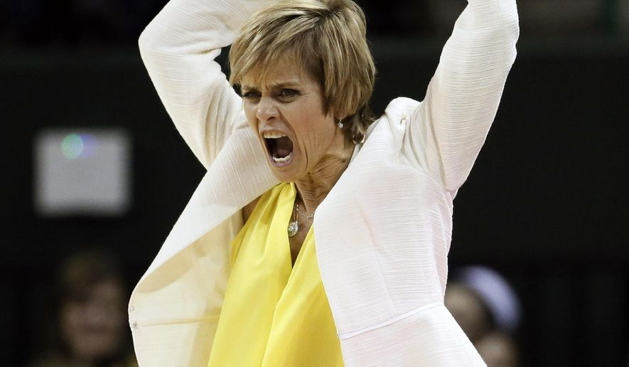 Baylor head coach Kim Mulkey waves her arms trying to motivate fans late in the second half of an NCAA college basketball game against Oklahoma Wednesday, Feb. 11, 2015, in Waco, Texas. Baylor won 89-66. (AP Photo/Tony Gutierrez)