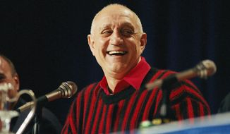 FILE - In this April 2, 1990, file photo UNLV head coach Jerry Tarkanian flashes a big smile during a press conference prior to facing Duke in the NCAA Final Four in Denver. Hall of Fame coach Jerry Tarkanian, who built a basketball dynasty at UNLV but was defined more by his decades-long battle with the NCAA, died Wednesday, Feb. 11, 2015, in Las Vegas after several years of health issues. He was 84. (AP Photo/Eric Risberg, File)