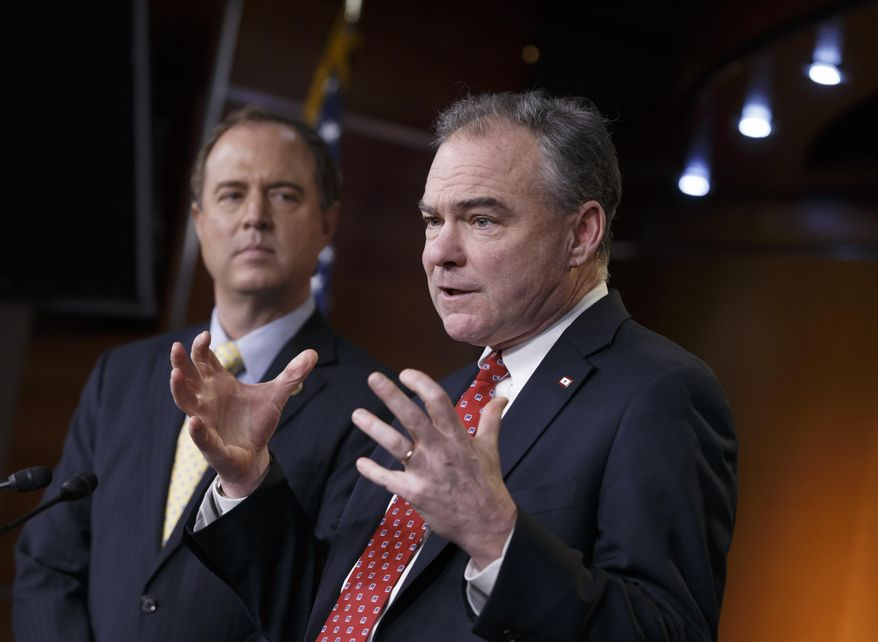 """Sen. Tim Kaine, D-Va., right, accompanied by Rep. Adam Schiff, D-Calif., gestures during a news conference on Capitol Hill in Washington, Wednesday, Feb. 11, 2015, to reflect on President Barack Obama's request to Congress to authorize military force against Islamic State fighters, asking lawmakers to """"show the world we are united in our resolve"""" to defeat militants who have overrun parts of the Middle East and threaten attacks on the U.S.  (AP Photo/J. Scott Applewhite)"""