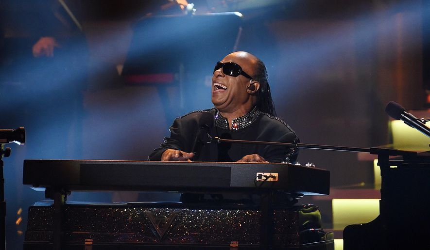 "Stevie Wonder performs during the finale of ""Stevie Wonder: Songs in the Key of Life - An All-Star Grammy Salute,"" at the Nokia Theatre L.A. Live on Tuesday, Feb. 10, 2015, in Los Angeles. (Photo by Chris Pizzello/Invision/AP)"