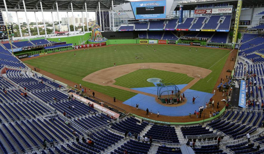 FILE - In this May 14, 2013, file photo, the Cincinnati Reds take batting practice at Marlins Park before a baseball game against the Miami Marlins in Miami. A person familiar with the decision says the Marlins have been awarded the 2017 All-Star Game, and an announcement by baseball Commissioner Rob Manfred is planned for this week at the team's ballpark.  (AP Photo/Lynne Sladky, File)