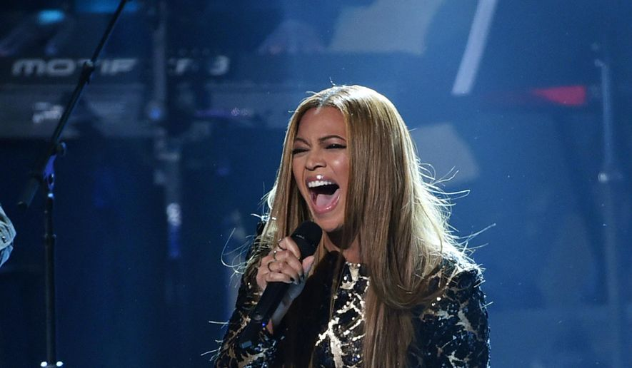 Beyonce performs at a Grammy salute to Stevie Wonder on Tuesday, Feb. 10, 2015 in Los Angeles. (Photo by Chris Pizzello/Invision/AP)
