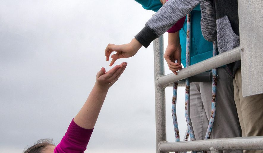 ADVANCED FOR MONDAY FEB 16 AND THEREAFTER Although the girls from 6th grade Lyford Middle School took turns at the live basin, some shared with their friends who were on the upper platform waiting their turn, Feb. 9, 2015. (AP Photo/Valley Morning Star, David Pike)