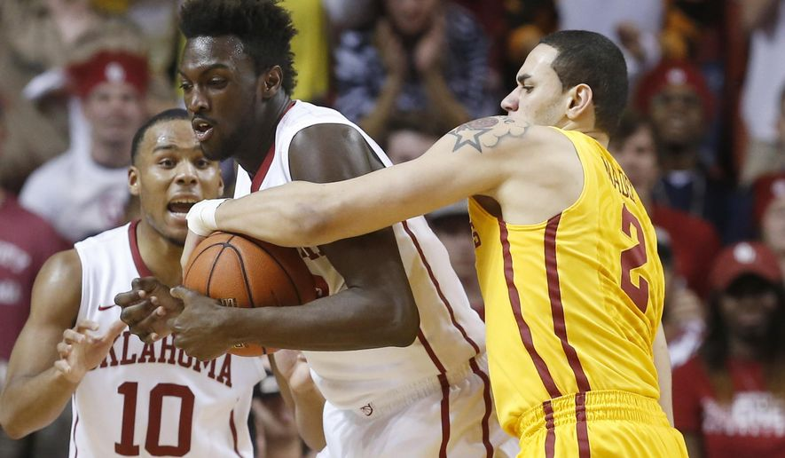 Oklahoma forward Khadeem Lattin, center, fights for control of the ball with Iowa State forward Abdel Nader (2) in the second half of an NCAA college basketball game in Norman, Okla., Monday, Feb. 9, 2015. Oklahoma guard Jordan Woodard is at left. Oklahoma won 94-83. (AP Photo/Sue Ogrocki)
