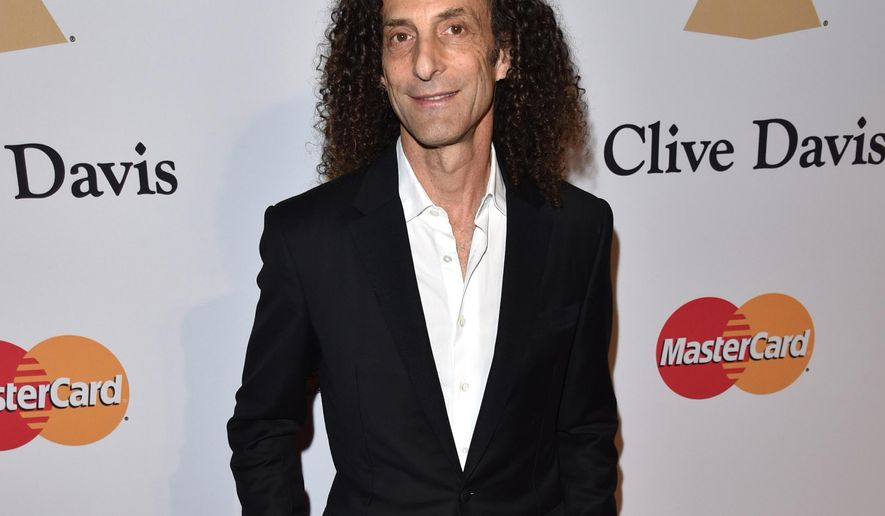 "FILE-- In this Saturday, Feb. 7, 2015 file photo, Kenny G arrives at the 2015 Clive Davis Pre-Grammy Gala at the Beverly Hilton Hotel in Beverly Hills, Calif. The 58-year-old artist, born Kenneth Gorelick, hungers for a certain cachet beyond platinum plaques. He'd like tunes from his latest album, ""Brazilian Nights"" mixed in on traditional jazz radio between the likes of Stan Getz and Miles Davis.  (Photo by John Shearer/Invision/AP, File)"
