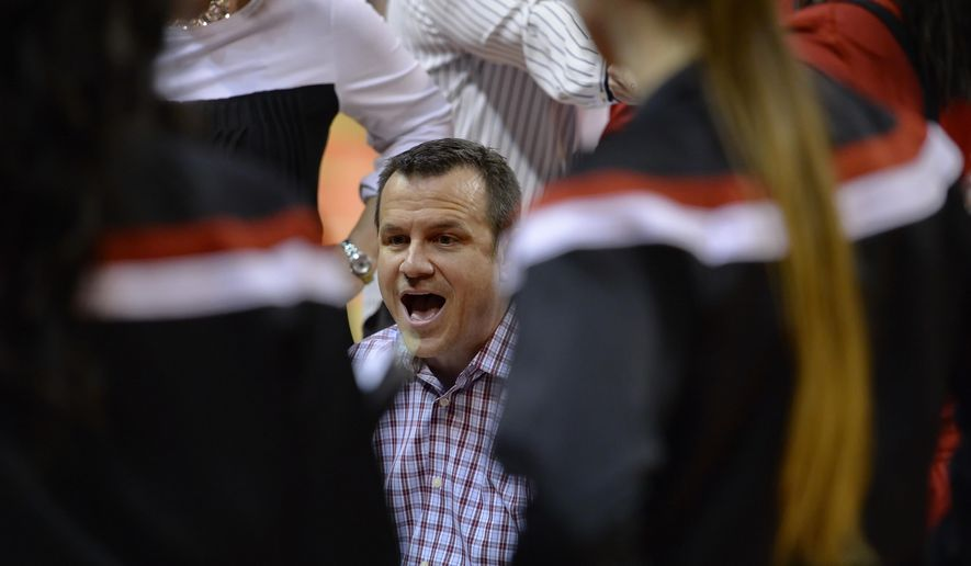 Louisville coach Jeff Walz talks to his team during a timeout in the first half of an NCAA college basketball game against Clemson on Thursday, Feb. 12, 2015, in Clemson, S.C. (AP Photo/Richard Shiro)