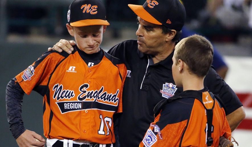 FILE - In this  Aug. 18, 2014 file photo, Cumberland manager David Belisle, center, talks with pitcher CJ Davock, left, and catcher Trey Bourque during the fifth inning of an elimination baseball game against Chicago at the Little League World Series tournament in South Williamsport, Pa. Chicago won 8-7. It was announced Wednesday, Feb. 11, 2015 that the Chicago team was stripped of it's national Little League title for using players from outside league boundaries. Belisle said Cumberland got beat by cheaters and the adults who orchestrated the scheme should be ashamed. (AP Photo/Gene J. Puskar, File)