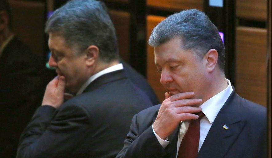 Ukrainian President Petro Poroshenko and the leaders of Russia, Ukraine, France and Germany on Thursday emerged from marathon 16-hour talks to announce a comprehensive peace deal for eastern Ukraine. (Associated Press)