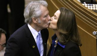 Oregon Gov. John Kitzhaber, a Democrat, faced increasing pressure Thursday within his own party to resign over accusations that his fiancee, Cylvia Hayes, sought to use her relationship with the governor to land lucrative consulting contracts for her green energy consulting business. (Associated Press)