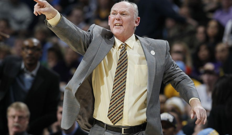 FILE - In this Feb. 25, 2013 file photo, Denver Nuggets head coach George Karl directs his team against the Los Angeles Lakers in the fourth quarter of an NBA game in Denver. The Sacramento Kings announced Thursday that they had reached an agreement in principle with George Karl to become the head coach. The team said a news conference to introduce Karl would be scheduled when the agreement is finalized. (AP Photo/David Zalubowski, File)