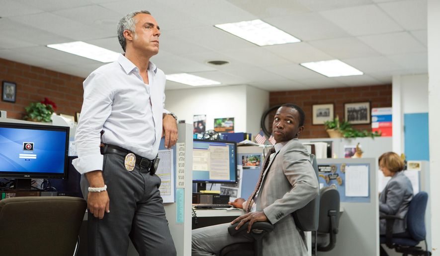"""This photo provided by Amazon Content Services LLC shows, Titus Welliver, left, as Harry Bosch, and Jamie Hector as Jerry Edgar, in a scene from drama series, """"Bosch."""" (AP Photo/Amazon Content Services LLC, Aaron Epstein)"""