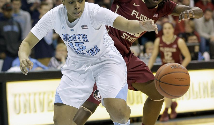 North Carolina's Allisha Gray (15) and Florida State's Shakayla Thomas chase the ball during the second half of an NCAA college basketball game in Chapel Hill, N.C., Thursday, Feb. 12, 2015. North Carolina won 71-63. (AP Photo/Gerry Broome)