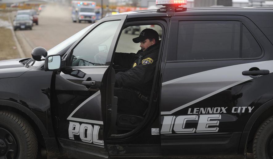 Police respond to a shooting at an industrial park, Thursday, Feb. 12, 2015, in Lennox, S.D. (AP Photo/The Argus Leader, Emily Spartz-Weerheim)  NO SALES