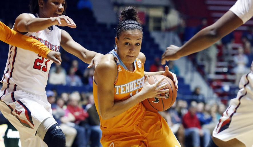 Tennessee guard Andraya Carter (14) dribbles past the defense of Mississippi guard Shandricka Sessom (23) during the first half of an NCAA college basketball game in Oxford, Miss., Thursday, Feb. 12, 2015. (AP Photo/Rogelio V. Solis)