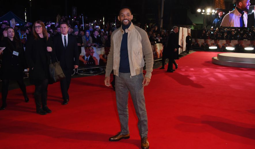 Actor Will Smith poses for photographers at the screening of Focus, at a central London cinema, Wednesday, Feb. 11, 2015. (Photo by Jonathan Short/Invision/AP)