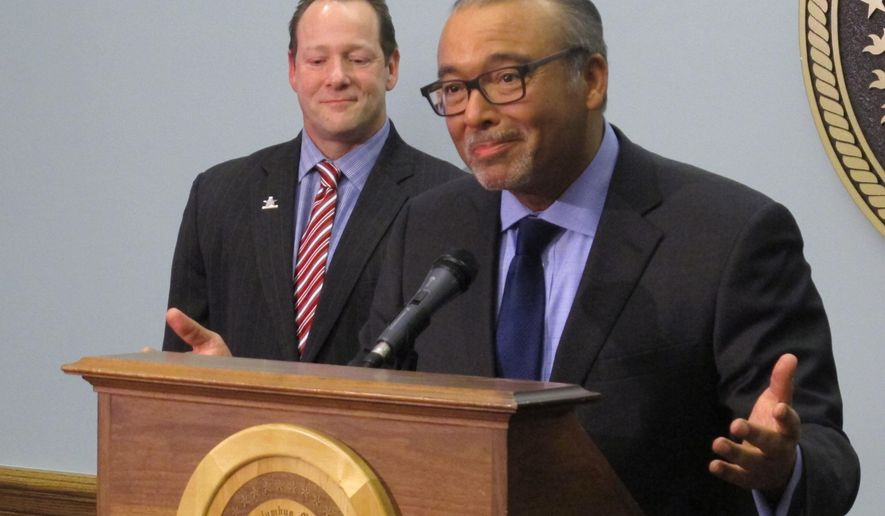 Columbus Mayor Michael Coleman, right, discusses Philadelphia's selection as the host of the 2016 Democratic National Convention over Columbus and Brooklyn, New York, as Brian Ross, president and CEO of Experience Columbus, listens in, on Thursday, Feb. 12, 2015, in Columbus, Ohio. Coleman said Columbus made great strides just to be a finalist. (AP Photo/Andrew Welsh-Huggins)