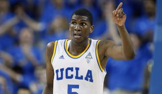 UCLA's Kevon Looney celebrates after dunking the ball against Oregon State during the first half of an NCAA college basketball game Wednesday, Feb. 11, 2015, in Los Angeles. (AP Photo/Danny Moloshok)
