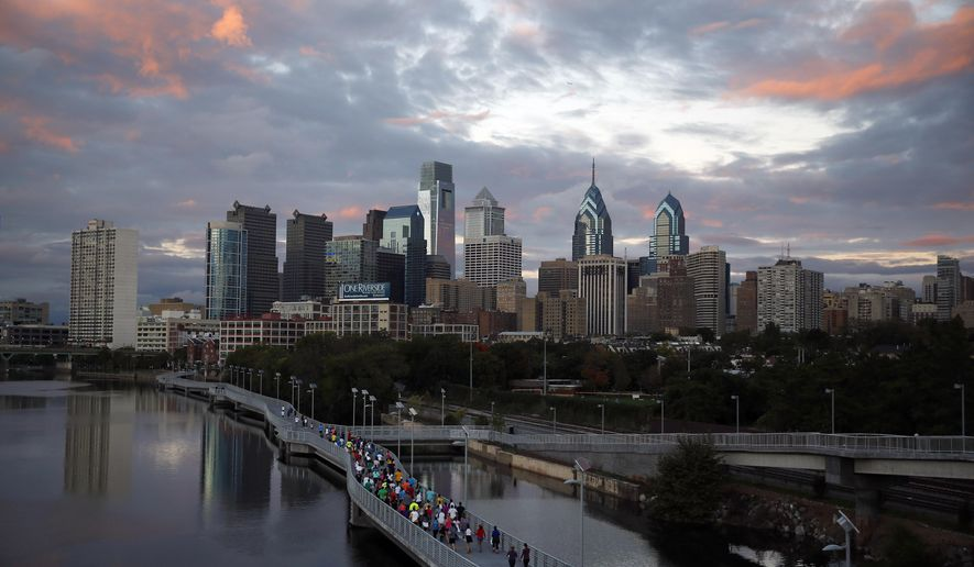 FILE - In this Oct. 1, 2014 file photo, runners jog along the Schuylkill Banks Boardwalk in Philadelphia. Democrats have selected Philadelphia as the site of the party's 2016 national convention, choosing a patriotic backdrop for the nomination of its next presidential candidate. The Democratic National Committee said Thursday, Feb. 12, 2015 the convention will be held the week of July 25, 2016. The two other finalists were Brooklyn, New York, and Columbus, Ohio. (AP Photo/Matt Slocum)