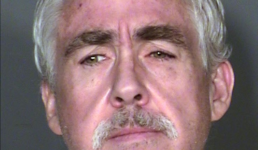 This undated booking photo provided by Clark County Detention Center shows Robert Dixon Dunn, 52, who is is scheduled for arraignment, Thursday, Feb. 12, 2015, in Las Vegas, on charges that he killed a couple, hid their bodies in a storage unit for more than 10 years and stole their Social Security benefits. (AP Photo/Clark County Detention Center)