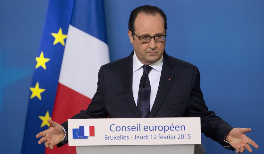 French President Francois Hollande speaks during a media conference after an EU summit in Brussels on Thursday, Feb. 12, 2015. European Union leaders on Thursday said the full respect of the planned weekend cease-fire in eastern Ukraine will be essential before there could be a change in the sanctions regime imposed on Moscow. (AP Photo/Michel Euler)